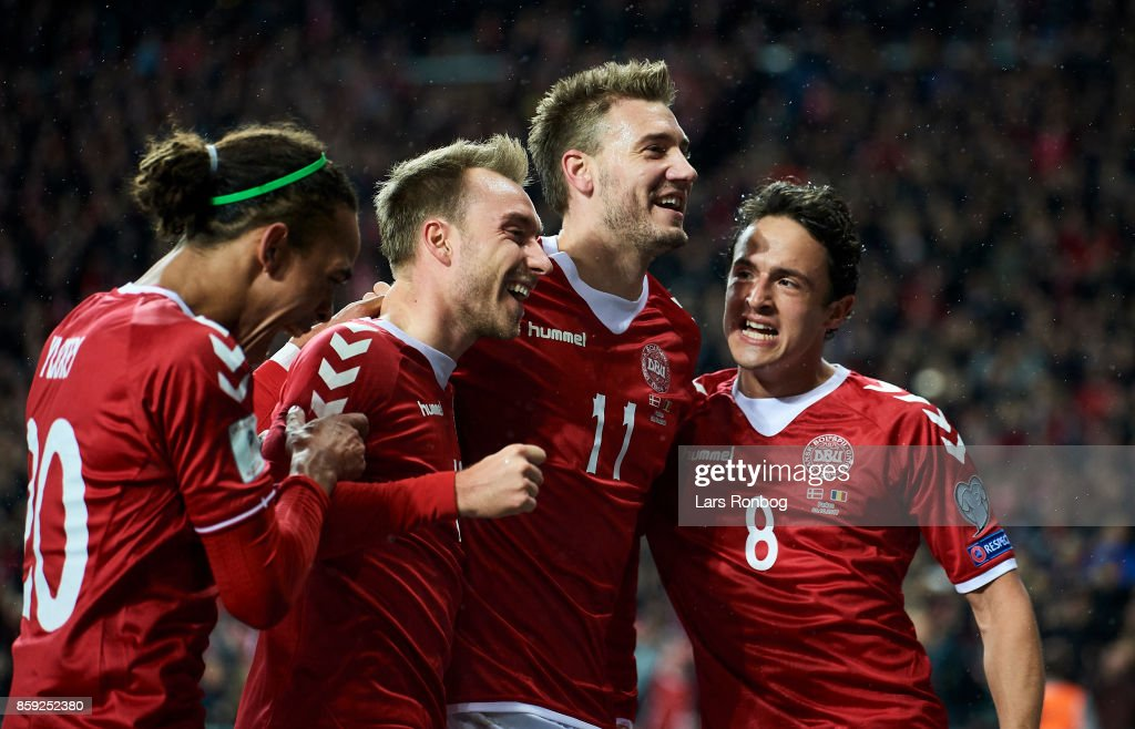 Yussuf Poulsen, Christian Eriksen, Nicklas Bendtner and Thomas Delaney of Denmark celebrate after scoring their first goal during the FIFA World Cup 2018 qualifier match between Denmark and Romania at Telia Parken Stadium on October 8, 2017 in Copenhagen, Denmark.