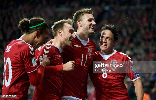 Yussuf Poulsen Christian Eriksen Nicklas Bendtner and Thomas Delaney of Denmark celebrate after scoring their first goal during the FIFA World Cup...