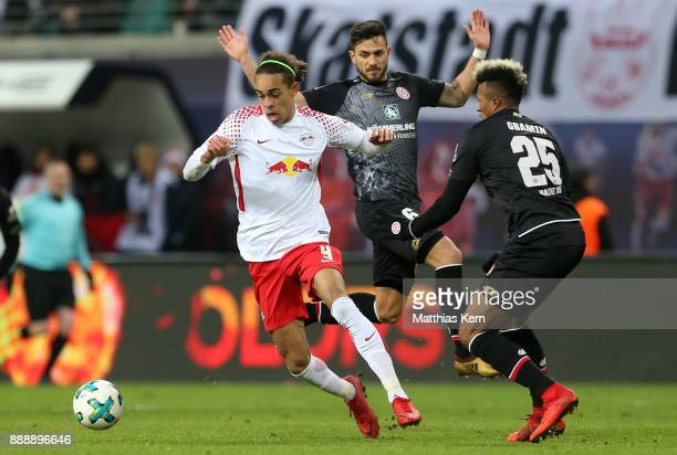 Yussuf Poulsen Danny Latza and Jean Philippe Gbamin battle for the ball during the Bundesliga match between RB Leipzig and 1FSV Mainz 05 at Red Bull...