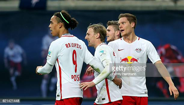 Yussuf Poulsen Emil Forsberg Timo Werner and Marcel Halstenberg of Leipzig celebrate their teams third goal behind goalkeeper Jonas Loessl of Mainz...