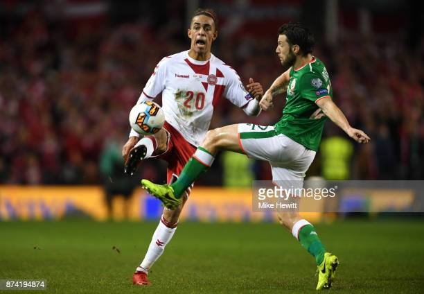 Yussuf Poulsen of Denmark and Harry Arter of the Republic of Ireland battle for possession during the FIFA 2018 World Cup Qualifier PlayOff Second...