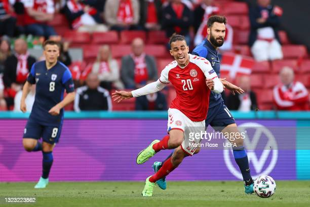 Yussuf Poulsen of Denmark battles for possession with Tim Sparv of Finland during the UEFA Euro 2020 Championship Group B match between Denmark and...