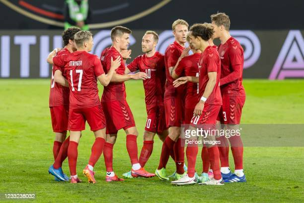 Yussuf Poulsen of Denmark celebrates after scoring his team's first goal with teammates during the international friendly match between Germany and...