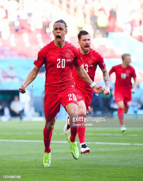 Yussuf Poulsen of Denmark celebrates after scoring their side's first goal during the UEFA Euro 2020 Championship Group B match between Denmark and...