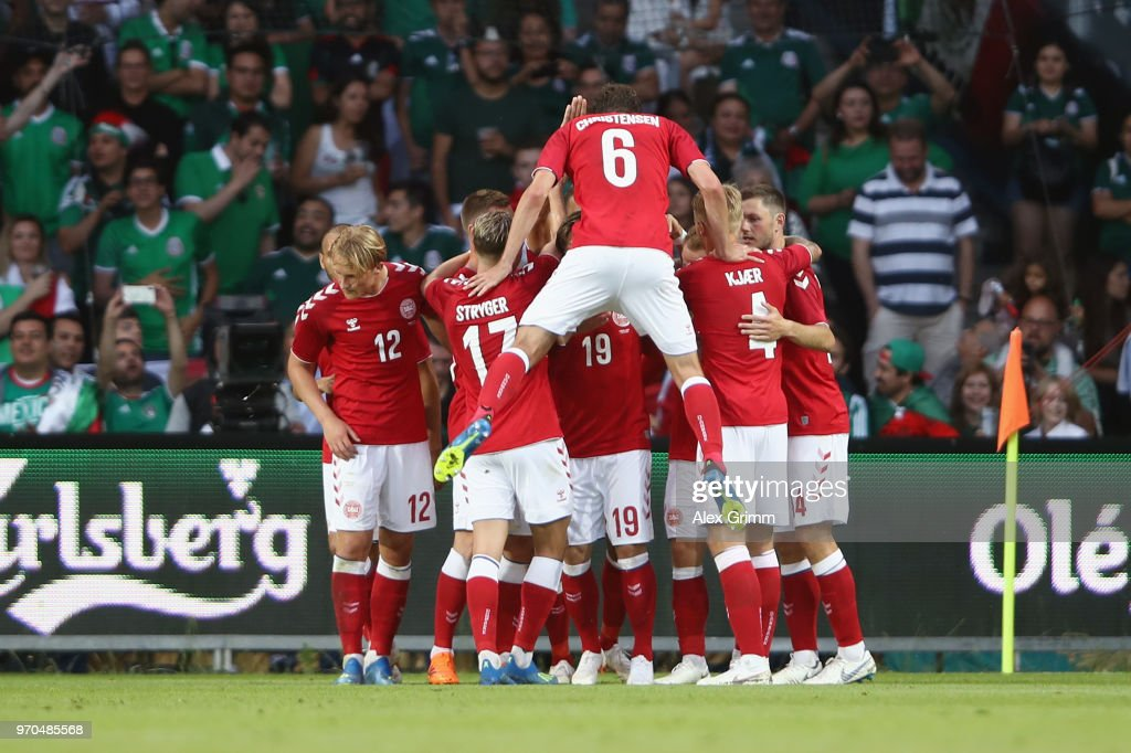 Yussuf Poulsen (covered) of Denmark celebrates his team's first goal with team mates during the international friendly match between Denmark and Mexico ahead of the FIFA World Cup Russia 2018 at Brondby Stadion on June 9, 2018 in Brondby, Denmark.
