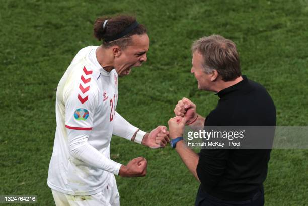 Yussuf Poulsen of Denmark celebrates with Kasper Hjulmand, Head Coach of Denmark after scoring their side's second goal during the UEFA Euro 2020...