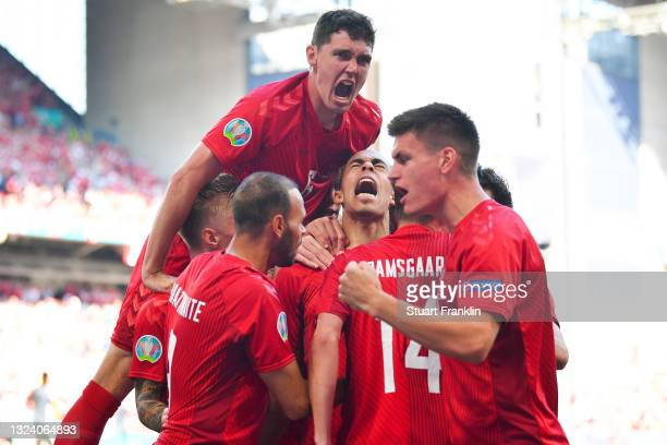 Yussuf Poulsen of Denmark celebrates with team mates after scoring their side's first goal during the UEFA Euro 2020 Championship Group B match...
