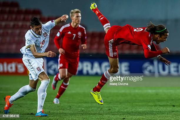 Yussuf Poulsen of Denmark fights with Lazar Cirkovic of Serbia during UEFA U21 European Championship Group A match between Denmark and Serbia at...