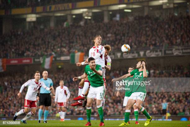 Yussuf Poulsen of Denmark jumps for the ball with Stephen Ward of Ireland during the FIFA World Cup 2018 PlayOff match between Republic of Ireland...