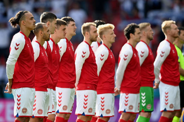Yussuf Poulsen of Denmark stands with team mates for the national anthem prior to the UEFA Euro 2020 Championship Group B match between Denmark and...