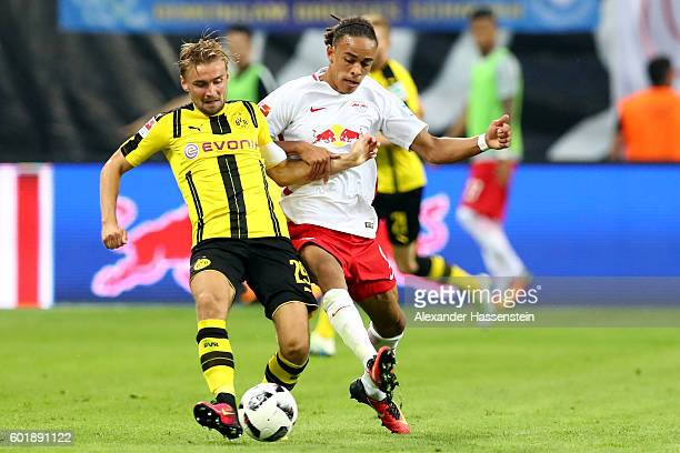 Yussuf Poulsen of Leipzig battles for the ball with Marcel Schmelzer of Dortmund during the Bundesliga match between RB Leipzig and Borussia Dortmund...