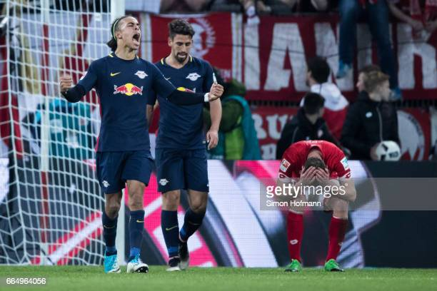 Yussuf Poulsen of Leipzig celebrates winning after the Bundesliga match between 1 FSV Mainz 05 and RB Leipzig at Opel Arena on April 5 2017 in Mainz...