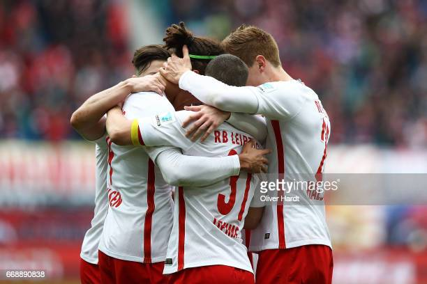 Yussuf Poulsen of Leipzig celebrates with teammates after heading his team's first goal during the Bundesliga match between RB Leipzig and SC...