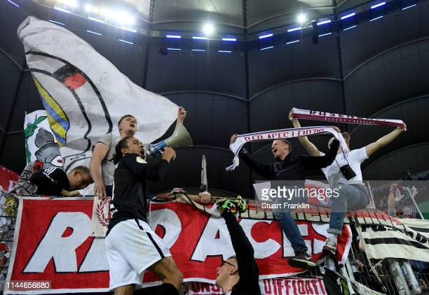 Yussuf Poulsen of Leipzig celebrates with their fans after winning the DFB Cup semi final match between Hamburger SV and RB Leipzig at Imtech Arena...