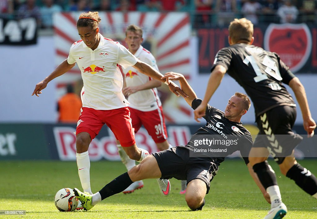 Yussuf Poulsen of Leipzig challenges John Verhoek of St. Pauli during the Second League match between RB Leipzig and FC St.Pauli at Red-Bull Arena on August 23, 2015 in Leipzig, Germany.