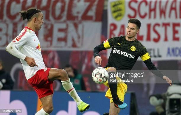 Yussuf Poulsen of Leipzig challenges Julian Weigl of Dortmund during the first Bundesliga match between RB Leipzig and Borussia Dortmund at Red Bull...