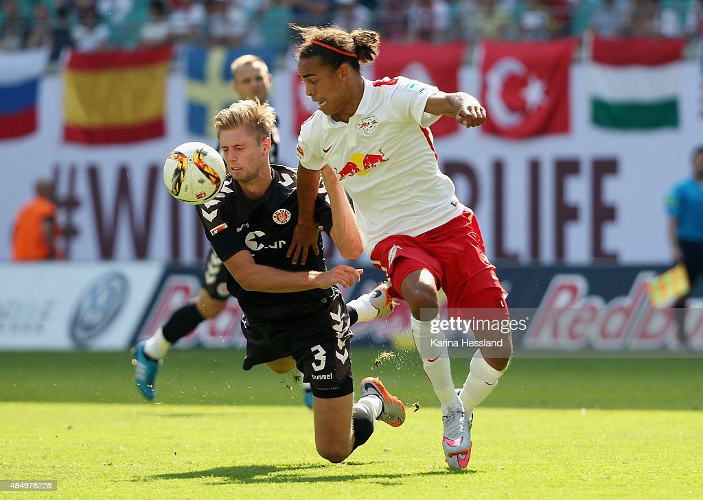 Yussuf Poulsen of Leipzig challenges Lasse Sobiech of St. Pauli during the Second League match between RB Leipzig and FC St.Pauli at Red-Bull Arena on August 23, 2015 in Leipzig, Germany.