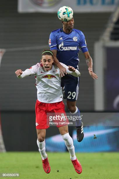 Yussuf Poulsen of Leipzig fights for the ball with Naldo of Schalke during the Bundesliga match between RB Leipzig and FC Schalke 04 at Red Bull...