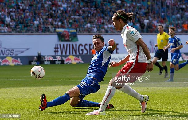 Yussuf Poulsen of Leipzig is challenged by Bjarne Thoelke of Karlsruhe during the Second Bundesliga match between RB Leipzig and Karlsruher SC at Red...