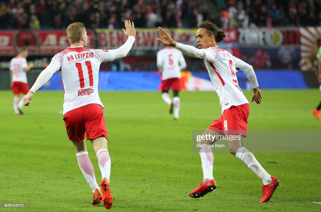 Yussuf Poulsen (R) of Leipzig jubilates with team mate Timo Werner after scoring the second goal during the Bundesliga match between RB Leipzig and Hannover 96 at Red Bull Arena on November 4, 2017 in Leipzig, Germany.