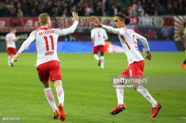 Yussuf Poulsen of Leipzig jubilates with team mate Timo Werner after scoring the second goal during the Bundesliga match between RB Leipzig and...