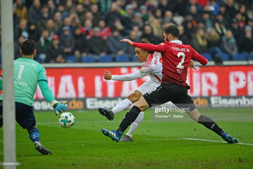Yussuf Poulsen (C) of Leipzig misses to score against Philipp Tschauner (L) and Josip Elez (R) of Hannover during the Bundesliga match between Hannover 96 and RB Leipzig at HDI-Arena on March 31, 2018 in Hanover, Germany.
