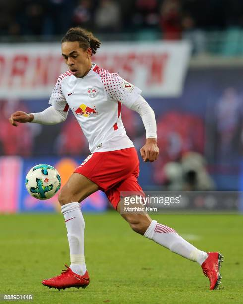 Yussuf Poulsen of Leipzig runs with the ball during the Bundesliga match between RB Leipzig and 1FSV Mainz 05 at Red Bull Arena on December 9 2017 in...