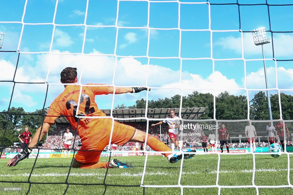 Yussuf Poulsen of Leipzig scores his team's fifth goal from the penalty spot against goalkeeper Christian Zech of Dorfmerkingen during the DFB Cup first round match between Sportfreunde Dorfmerkingen and RB Leipzig at Ostalb-Arena on August 13, 2017 in Aalen, Germany.