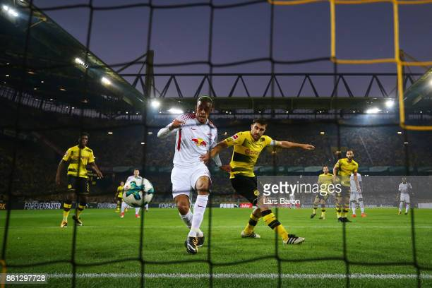 Yussuf Poulsen of Leipzig scores his teams second goal against Sokratis Papastathopoulos of Dortmund to make it 12 during the Bundesliga match...