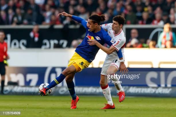 Yussuf Poulsen of RB Leipzig and Benjamin Pavard of VfB Stuttgart battle for the ball during the Bundesliga match between VfB Stuttgart and RB...