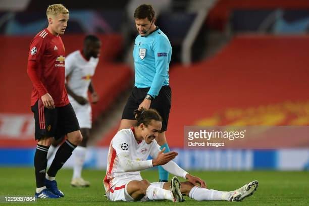 Yussuf Poulsen of RB Leipzig and Donny van de Beek of Manchester United and Referee Matej Jug look on during the UEFA Champions League Group H stage...