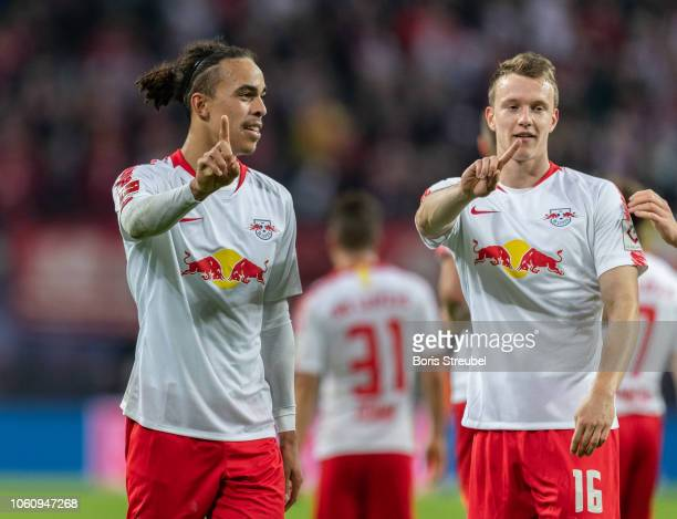 Yussuf Poulsen of RB Leipzig and Lukas Klostermann of RB Leipzig celebrate during the Bundesliga match between RB Leipzig and Bayer 04 Leverkusen at...