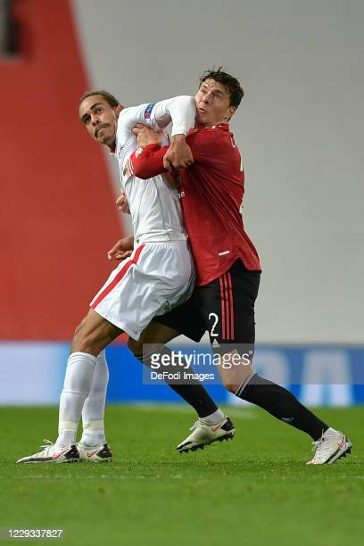 Yussuf Poulsen of RB Leipzig and Victor Lindeloef of Manchester United battle for the ball during the UEFA Champions League Group H stage match...