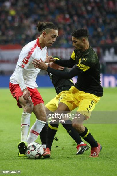 Yussuf Poulsen of RB Leipzig battles for possession with Achraf Hakimi of Borussia Dortmund during the Bundesliga match between RB Leipzig and...