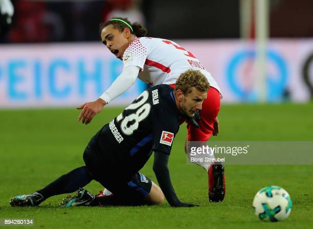 Yussuf Poulsen of RB Leipzig battles for the ball with Fabian Lustenberger of Hertha BSC during the Bundesliga match between RB Leipzig and Hertha...