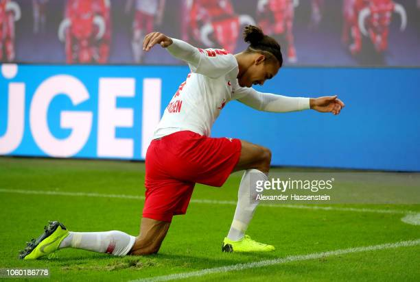 Yussuf Poulsen of RB Leipzig celebrates after scoring his team's first goal during the Bundesliga match between RB Leipzig and Bayer 04 Leverkusen at...
