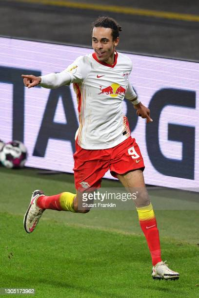 Yussuf Poulsen of RB Leipzig celebrates after scoring their side's first goal during the DFB Cup quarter final match between RB Leipzig and VfL...