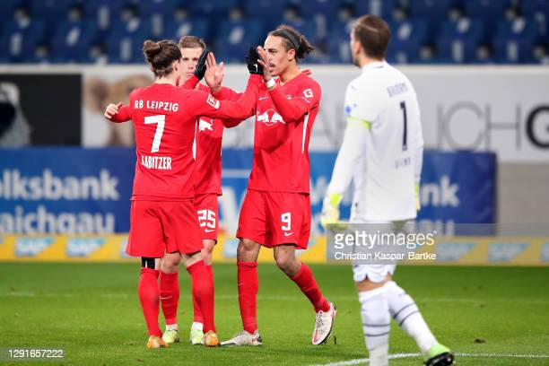 Yussuf Poulsen of RB Leipzig celebrates after scoring their team's first goal with Marcel Sabitzer and Dani Olmo during the Bundesliga match between...