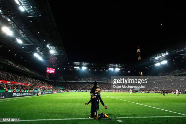 Yussuf Poulsen of RB Leipzig celebrates scoring his teams second goal of the game during the Bundesliga match between 1 FC Koeln and RB Leipzig at...