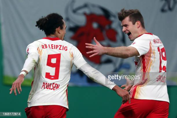 Yussuf Poulsen of RB Leipzig celebrates with Alexander Sorloth after scoring their side's first goal during the DFB Cup quarter final match between...
