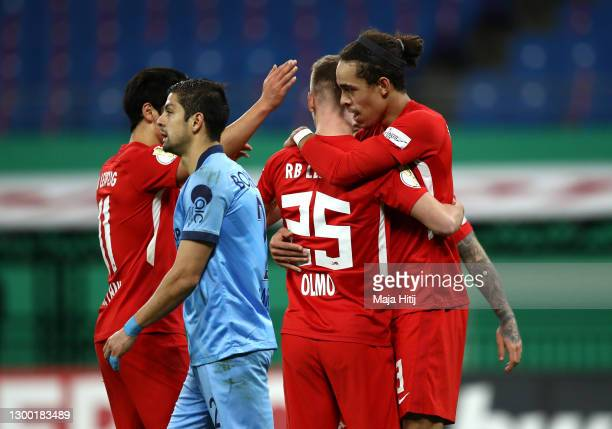 Yussuf Poulsen of RB Leipzig celebrates with Dani Olmo after scoring his team's third goal during the DFB Cup Round of Sixteen match between RB...