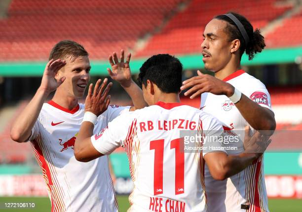 Yussuf Poulsen of RB Leipzig celebrates with Hwang Hee-chan and Dani Olmo after scoring his team's second goal during the DFB Cup first round match...