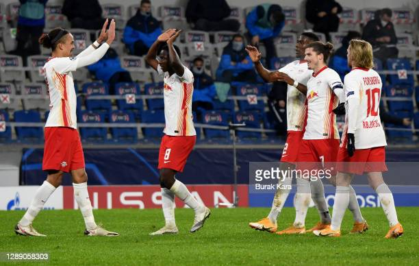 Yussuf Poulsen of RB Leipzig celebrates with team mate Amadou Haidara after scoring their sides first goal during the UEFA Champions League Group H...