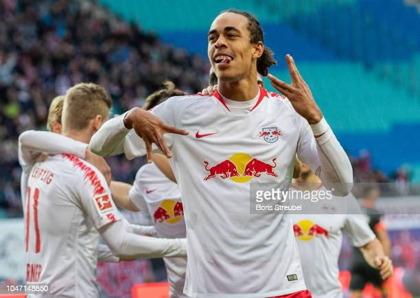 Yussuf Poulsen of RB Leipzig celebrates with team mates after scoring his team's second goal during the Bundesliga match between RB Leipzig and 1 FC...