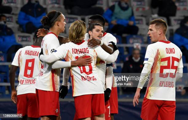Yussuf Poulsen of RB Leipzig celebrates with team mates Amadou Haidara , Emil Forsberg Marcel Sabitzer and Dani Olmo after scoring their sides first...