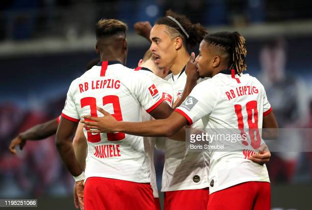 Yussuf Poulsen of RB Leipzig celebrates with teammates after scoring his team's third goal during the Bundesliga match between RB Leipzig and FC...