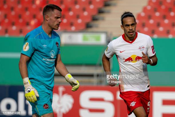 Yussuf Poulsen of RB Leipzig goalkeeper Christian Mathenia of 1FC Nuernberg during the DFB Cup first round match between 1 FC Nuernberg and RB...