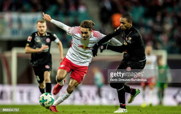 Yussuf Poulsen of RB Leipzig in action with Abdou Diallo of 1 FSV Mainz 05 during the Bundesliga match between RB Leipzig and 1 FSV Mainz 05 at Red...