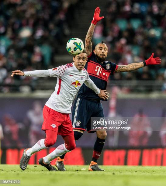 Yussuf Poulsen of RB Leipzig in action with Arturo Vidal of FC Bayern Muenchen during the Bundesliga match between RB Leipzig and FC Bayern Muenchen...