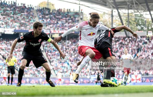Yussuf Poulsen of RB Leipzig in action with David Angel Abraham of Eintracht Frankfurt and Timothy Chandler of Eintracht Frankfurt during the...
